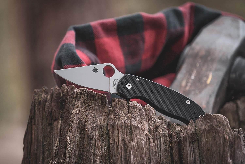 spyderco knife on wood surface