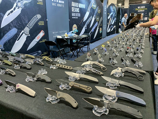 knives are displayed on a table in SHOT show.